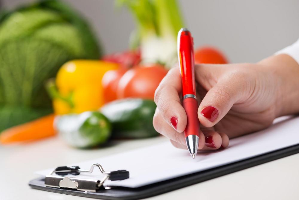 Doctor making a health and nutrition plan for client.